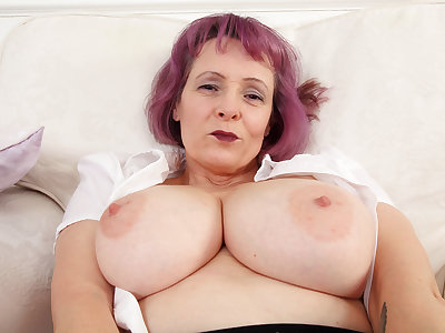 English milf Tigger plays with her big tits and fanny
