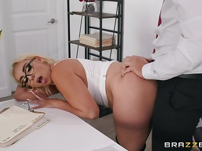 Blonde cougar enjoys a bit of naughty sex at a catch office