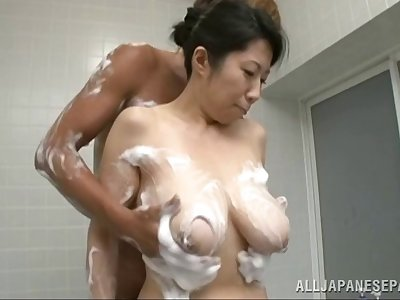 Bosomy coupled with saucy Asian slut gets cum on will not hear of titties there this shower scene