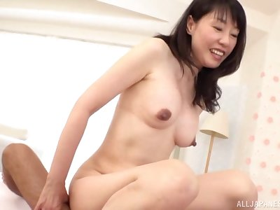 Japanese mature gets her hands on a fit dong for her voluptuous needs